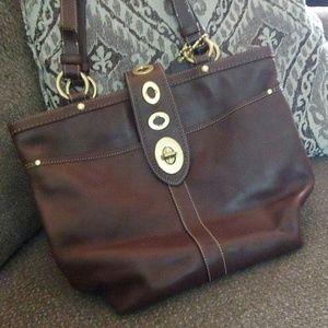 Coach brown handbag with stripe inner